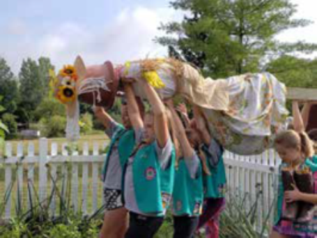 Girl scouts made a scarecrow