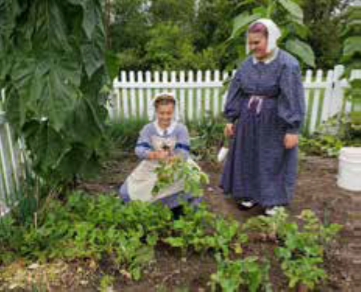Women in period dress in the garden